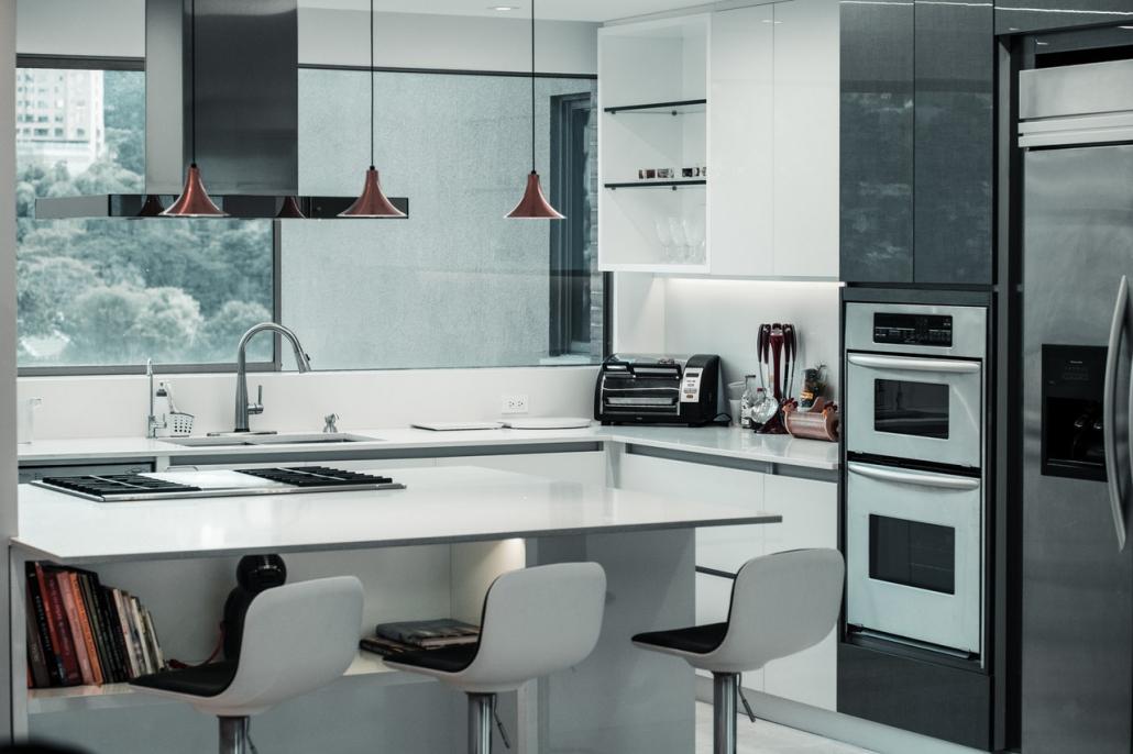 A modern black and white kitchen.