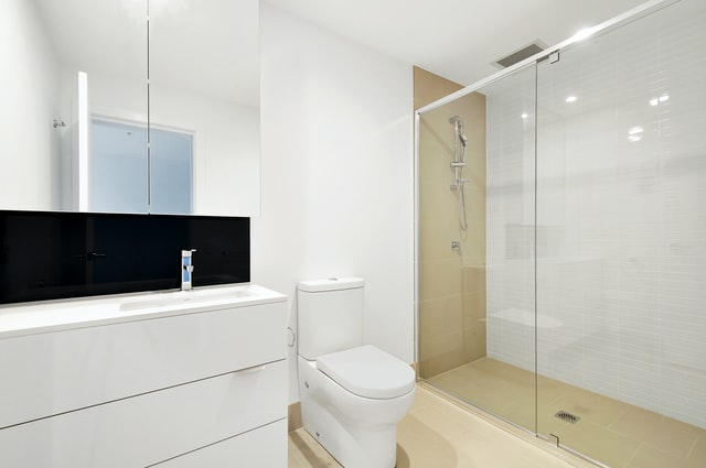 A white bathroom with easy toilet access